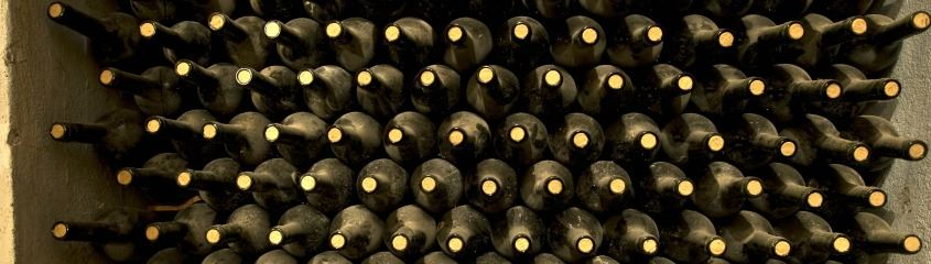 Dusty bottles of wine piled high at Mendoza winery
